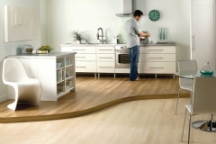 Laminate_flooring_kitchen_delivered_by_Inspire_Flooring_Aberdeen_where_a_man_is_preparing_a_cup_of_coffee